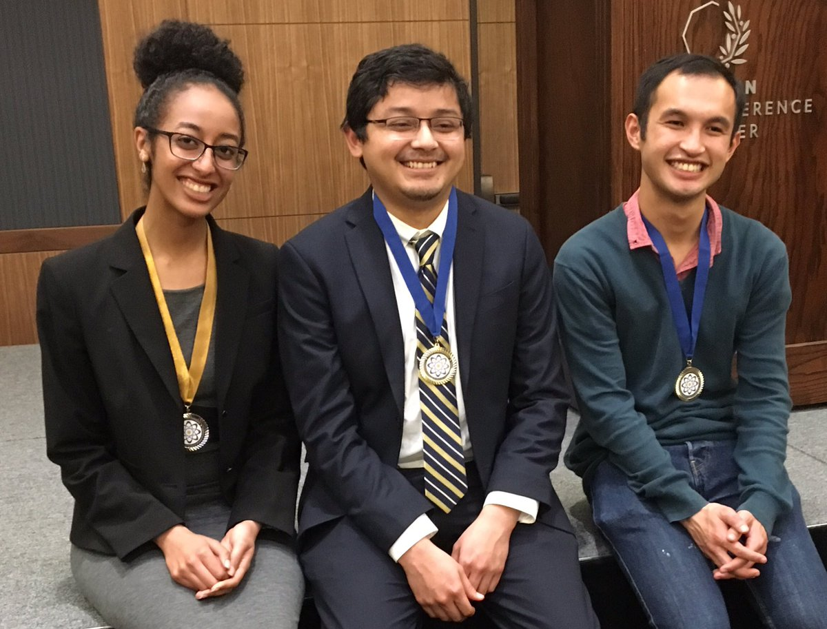 Three STEM students, each wearing a research poster medal with ribbon around their neck